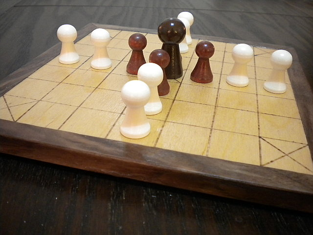 A close-up view of the Deluxe 13-piece Hnefatafl Game