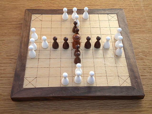 Compact 25-piece Hnefatafl game set up for tablut