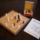 A game of sea battle tafl in progress on the Deluxe board.