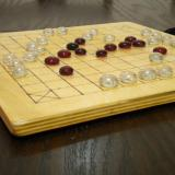 Basic 37-piece Hnefatafl Game in play, close-up.