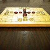 Close-up of 25-piece Hnefatafl Game, set out for play.
