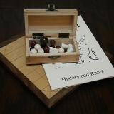 The Deluxe 13-piece Hnefatafl Game, with pieces in the box.