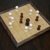 A game of brandub in progress on the Deluxe 13-piece Hnefatafl Game