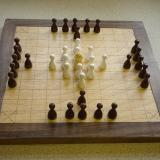 Compact 11x11 board, with reversed pieces.